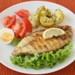 Fried fish with potato and salad — Stock Photo