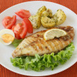 Fried fish with potato and salad — Stock Photo #8052474