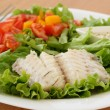 Boiled codfish with salad — Stock Photo