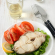 Boiled fish with glass of wine — Stock Photo