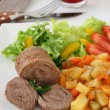 Meat rolls with salad - Stock Photo