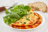 Omelet with lettuce — Stock Photo