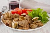 Pork with seafood and salad — Stock Photo