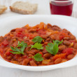 Boiled beans with tomato — Stock Photo