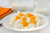 Cottage cheese with orange on the plate — Stock Photo