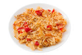 Rice with codfish and vegetables on the plate — Stock Photo