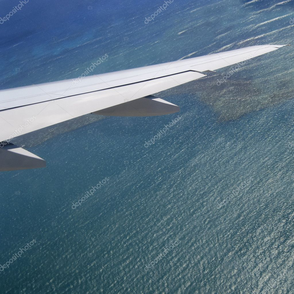 Square shot of airplane wings over shallow water — Stock Photo #8389209