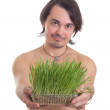 Man holding grass flowerpot isolated on white background — Stock Photo