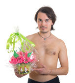 Man with a bouquet of artificial flowers isolated on white backg — Stock Photo