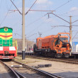 The multicolored diesel train and Railway heavy duty machines tr — Stock Photo #10099297