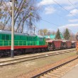 The multicolored diesel train and Railway heavy duty machines tr — Stock Photo