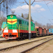 The multicolored diesel train on the rails — Stock Photo #10099302