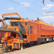 Railway heavy duty machines train on the station - Stock Photo