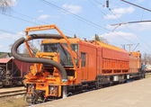 Railway heavy duty machines train on the station — Stock Photo