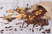Chocolates, Coffee beans and almonds in canvas sack — Stock Photo