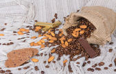 Cookies, chocolates, Coffee beans and almonds in canvas sack — Stockfoto