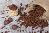 Sweets and cup of coffee beans — Stockfoto