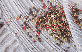 Colorful peppercorns on a canvas background — ストック写真