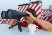 Man with binoculars on the roof — Stock Photo