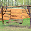 Stock Photo: Old wood swing in garden