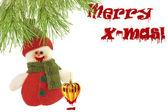 Cute snowman under a pine tree and a Merry christmas sign, writt — Stock Photo