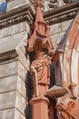 Statue of Saint Paul on the facade of St. Nicholas Roman Catholi — Stock Photo