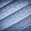 Metal plate with rivets, textural background - Stockfoto