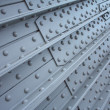Stock Photo: Metal plate with rivets, textural background