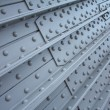 Metal plate with rivets, textural background — Stock Photo