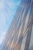 Modern office building on sky background — Stock Photo