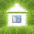 Conceptual green grass house isolated on white — Stok fotoğraf