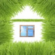 Conceptual green grass house isolated on white - Photo