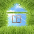 Stock Photo: Conceptual Green Grass House On Sky Background