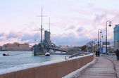 Cruiser Aurora (Warship museum) and Neva embankment. St. Petersb — Stock Photo