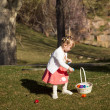 Toddler on Easter Egg Hunt - Stock Photo