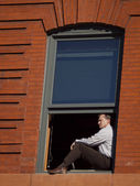 Businessman in window — Stock Photo