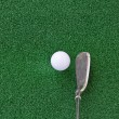 Golf club and ball on the artificial turf,Looking down at the An — Stock Photo