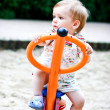 Little blonde boy playing on the swing.  Summer — Foto Stock