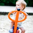 Little blonde boy playing on the swing.  Summer — Stock Photo
