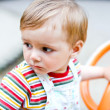 Royalty-Free Stock Photo: Baby boy on a swing