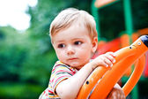 Young boy or kid playing at playground — Stock Photo