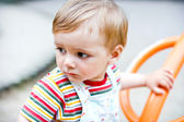Baby boy on a swing — Stock Photo
