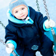 Portrait of child  on swing playground outdoors — Stock Photo