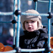 A boy on a playground, winter time — Stock Photo