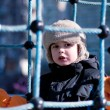 Stock Photo: Boy on playground, winter time