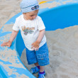 Little boy play in the sand box — Stock Photo