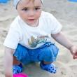 Royalty-Free Stock Photo: Adorable toddler playing   in the sandbox. Summer