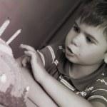 Boy on his birthday, making a wish — Stock Photo