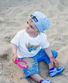 A little boy in the sandbox — Stock Photo