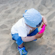 Stock Photo: Small boy playing in sandbox. Summer